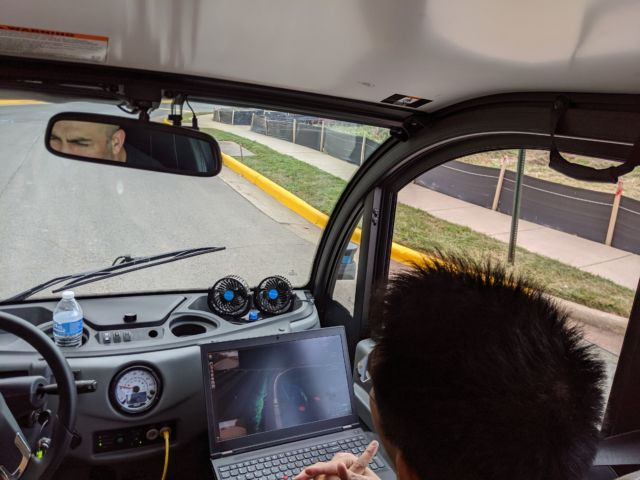 An Optimus Ride employee monitors the vehicle's progress.