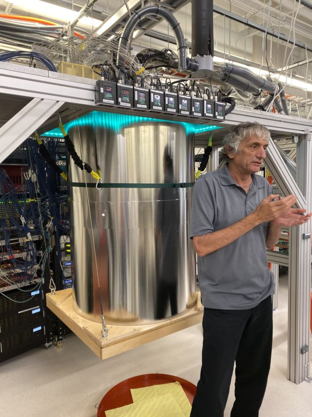 Here, Google researcher John Martinis stands in front of some of the hardware he has helped create. Google's version, with its bare metal and wooden platform, looks like it was made by graduate students, though the LEDs are a nice touch.