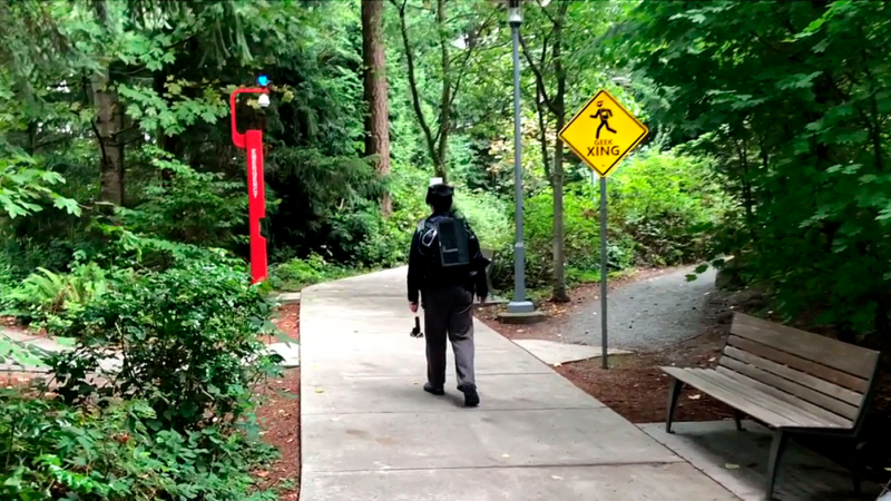 A user traverses a park while wearing a DreamWalker kit.