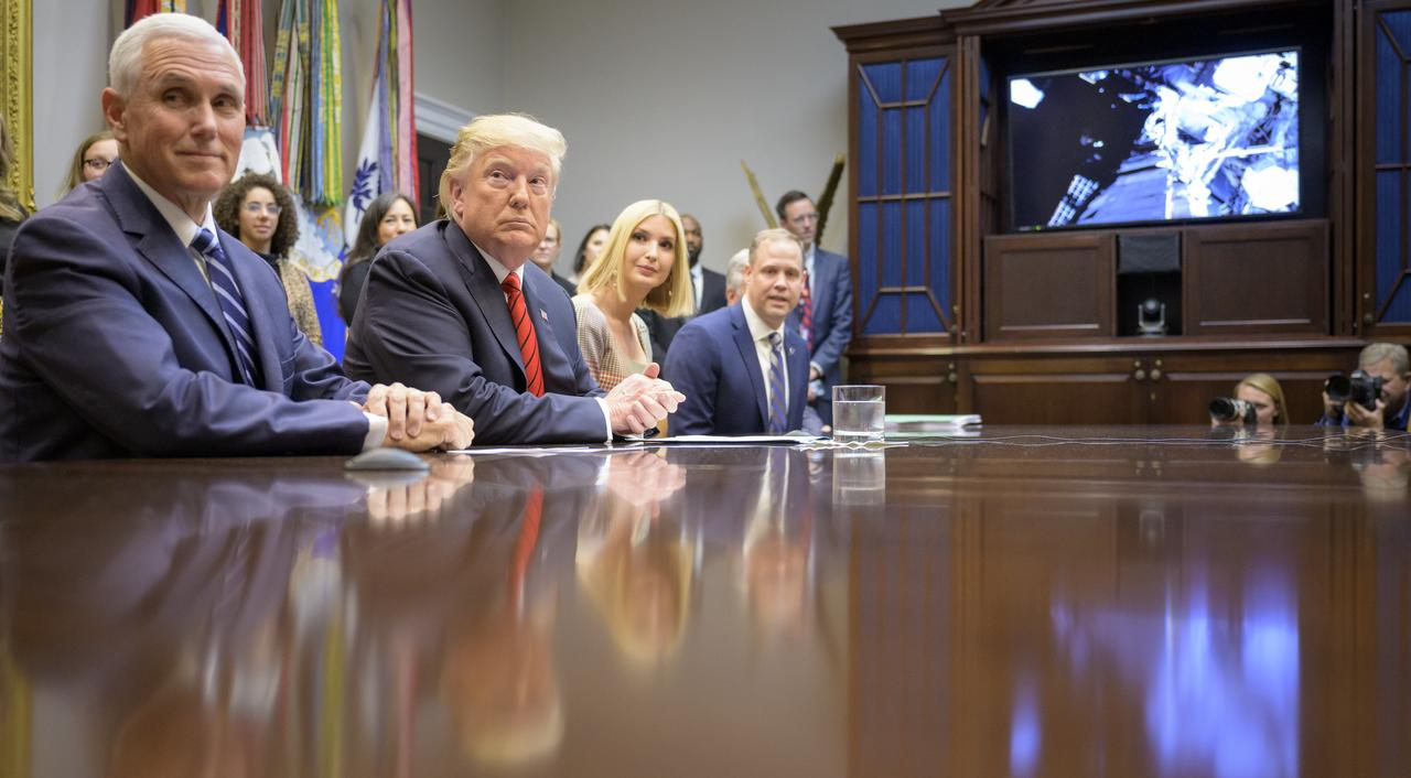 President Donald Trump, joined by Vice President Mike Pence, left, Ivanka Trump, and NASA Administrator Jim Bridenstine, right, speaks with NASA astronauts Christina Koch and Jessica Meir during the first all-woman spacewalk on Friday from the Roosevelt Room of the White House.