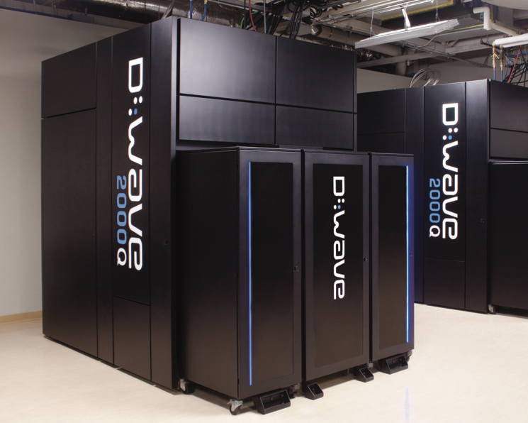 Image of large, black metal boxes that house D-Wave hardware.