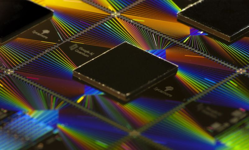 Image of a chip above iridescent wiring.