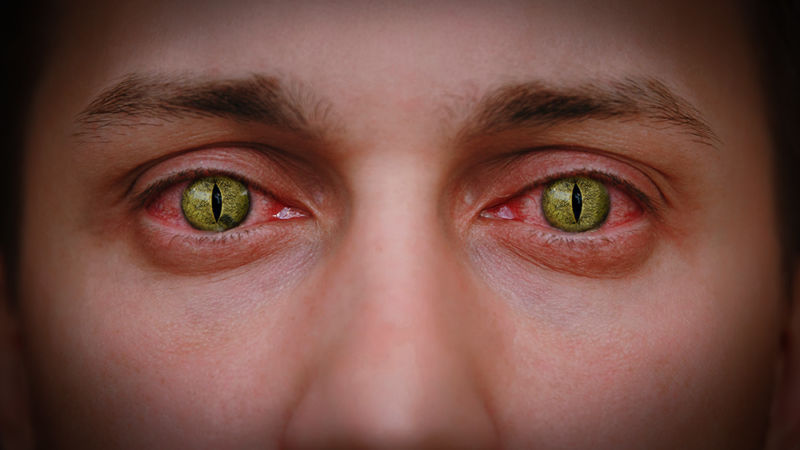 Closeup image of man wearing scary contact lenses.