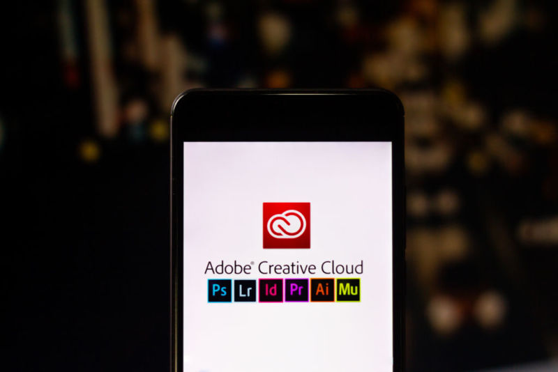 Photo illustration of Adobe Creative Cloud apps running on a smartphone.