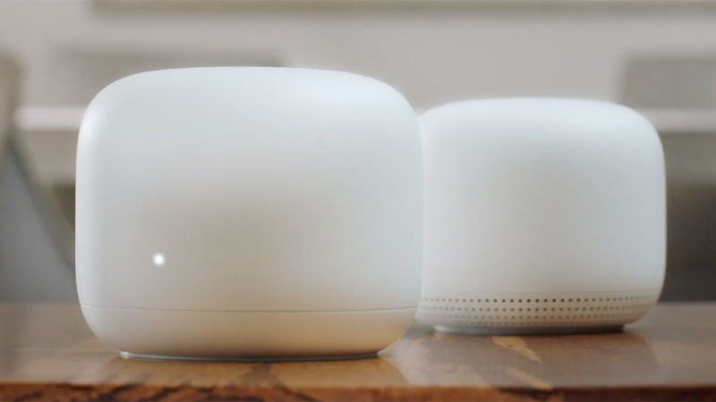 A Google Wifi Router sits next to a Google Wifi Point in this product shot from the Made by Google 2019 event.