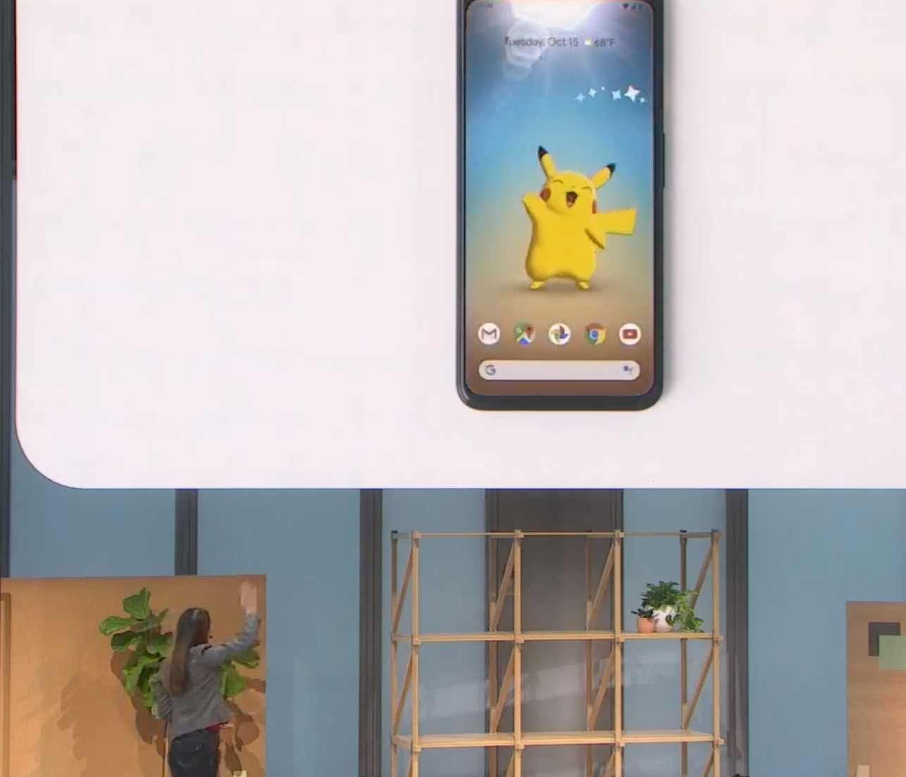 A faked representation of waving hi to a cartoon avatar on your phone screen. We doubt the Soli sensor reaches as far as this projector mock-up looks.
