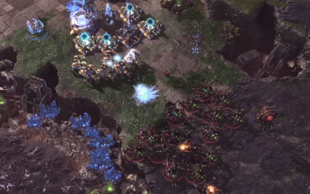AlphaStar (Zerg, in red) defending an early aggression where the opponent built part of the base near AlphaStar's base, showcasing robustness.