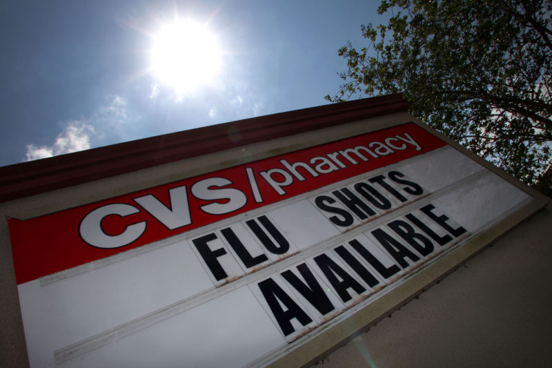 A chain pharmacy uses it sign to advertise flu shots.