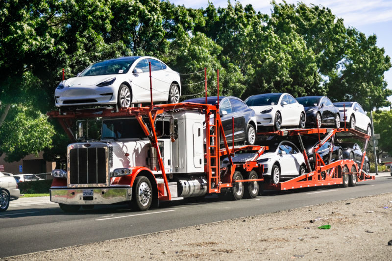 A truck full of Model 3 cars.