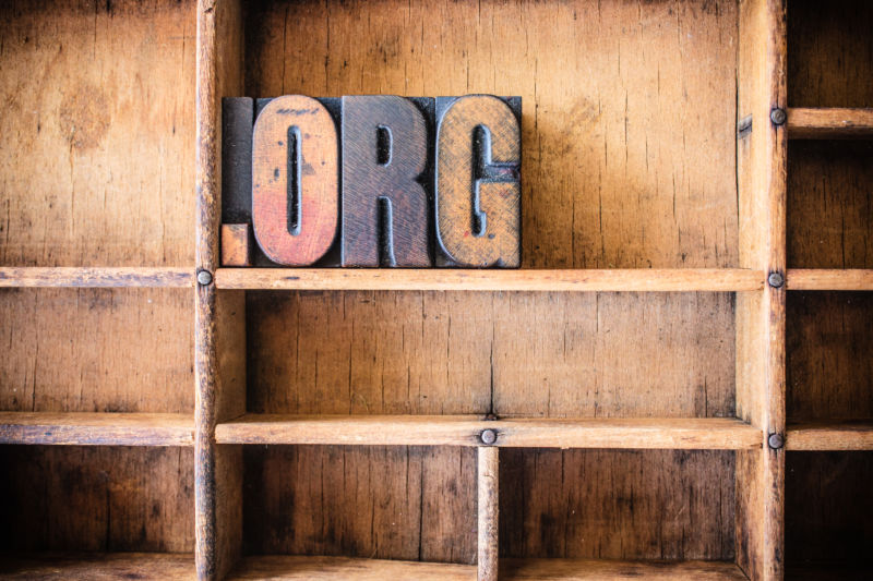 The word DOT ORG written in vintage wooden letterpress type in a wooden type drawer.
