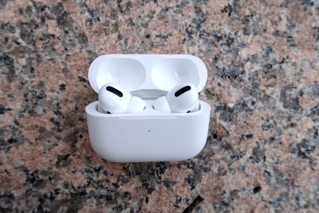 Apple's AirPods Pro inside an open case.