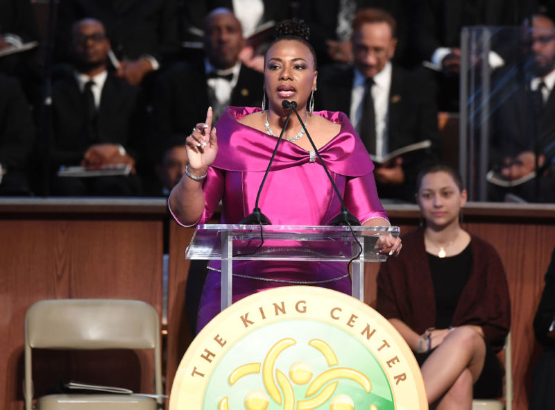 Bernice King, daughter of Dr. Martin Luther King Jr., speaks at a podium.