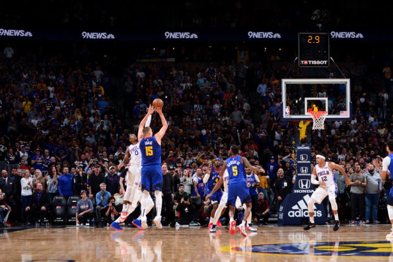 Nikola Jokic of the Denver Nuggets basketball team makes a game-winning shot from just inside the 3-point line.