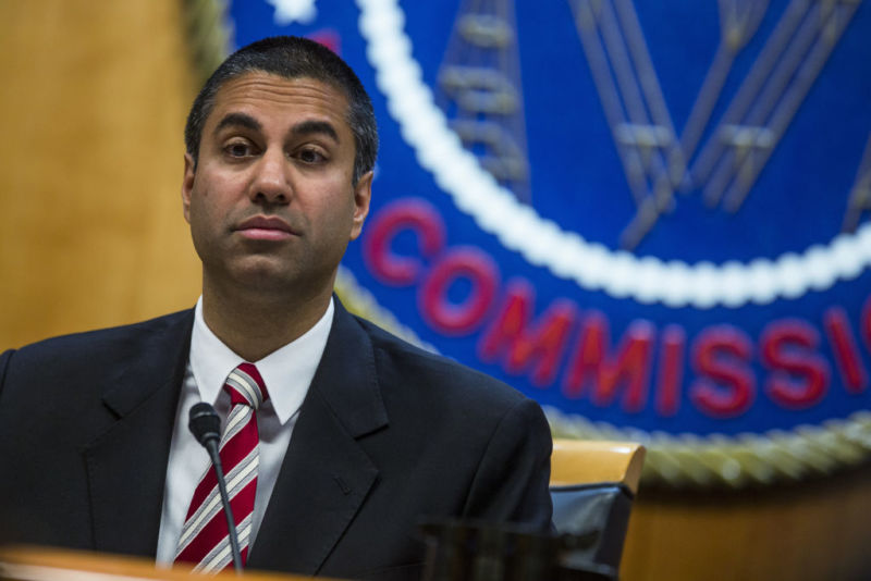 FCC Chairman Ajit Pai at a meeting, sitting in front of the FCC seal.