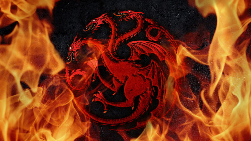 The emblem of a multi-headed dragon is engulfed in flames.