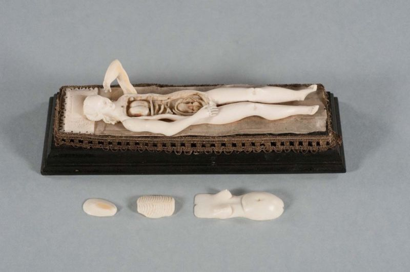 Ivory figurine carved in the shape of a naked woman.