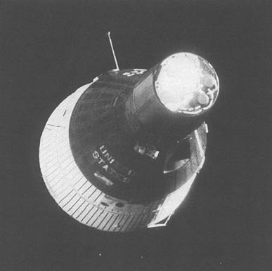 First orbital rendezvous: Gemini VI keeps station after using its on-board computer to maneuver to position near Gemini VII.