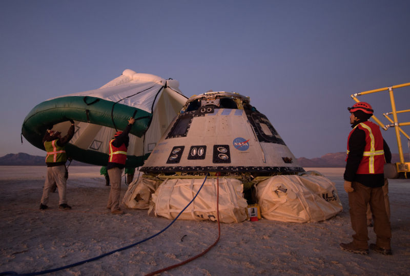A protective tent is placed over Starliner after it returned to Earth in December.