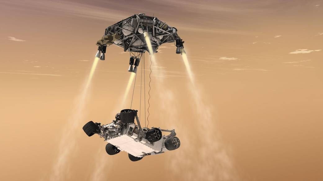An artist's concept shows the sky crane maneuver during the descent of NASA's Curiosity rover to the Martian surface.