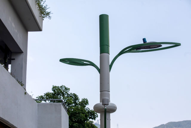 A smart lamppost stands in the Kai Tak area of Hong Kong, China. Hong Kong will install about 400 multi-functional smart lampposts in a pilot scheme to enhance the collection of real-time city data and support 5G mobile network implementation, according to the government's website.