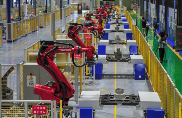 An automated robot production line at SIASUN Robot & Automation Co., Ltd. High-density IoT deployments could put monitoring tags on everything in this picture.