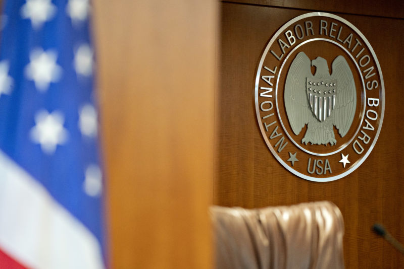 The National Labor Relations Board (NLRB) seal hangs inside a hearing room at the headquarters in Washington, D.C.
