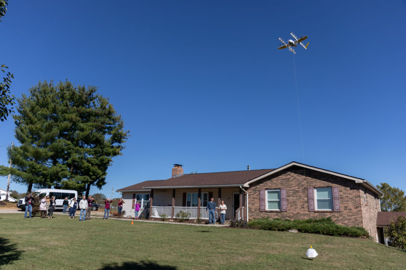 "Wing Aviation, a ""moonshot"" project of Google's Alphabet, delivers a package to a customer in October 2019. Wing was the first drone operator sanctioned by the FAA to deliver packages to customers, but a large scale deployment of technology like this depends on better location tracking systems."