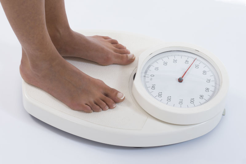 Woman on kg weight scale