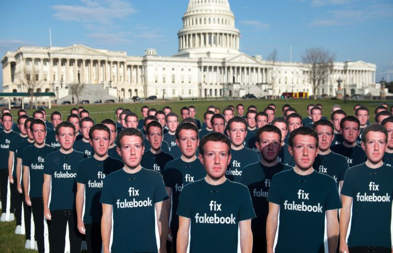 One hundred cardboard cutouts of Facebook founder and CEO Mark Zuckerberg stand outside the US Capitol in Washington, DC, April 10, 2018.