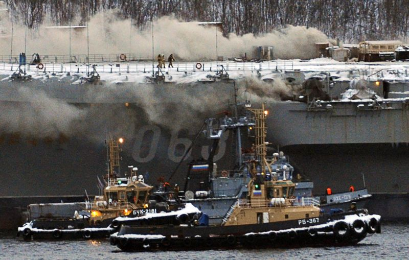 MURMANSK, RUSSIA - DECEMBER 12, 2019: A fire has broken out aboard the Project 11435 aircraft carrier Admiral Kuznetsov of the Russian Northern Fleet. Admiral Kuznetsov is the only aircraft carrier of the Russian Navy. Lev Fedoseyev/TASS
