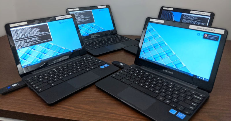 Behold the glory: four refurbished Chromebooks, each with an additional Linksys WUSB6300 Wi-Fi adapter for out-of-band control and communications.