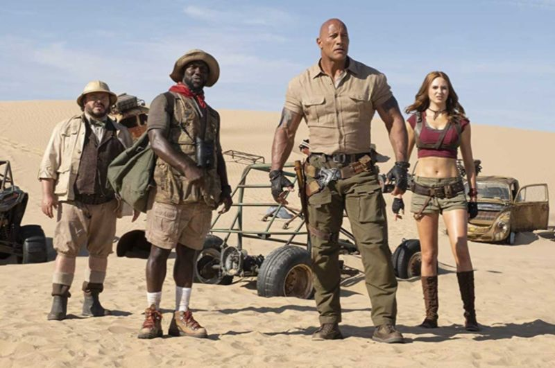 "Jack Black, Kevin Hart, Dwayne Johnson, and Karen Gillan star in <em>Jumanji: The Next Level</em>.""><figcaption class="