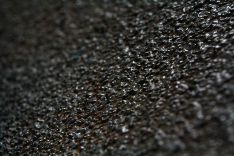 Image of a rough, textured surface.
