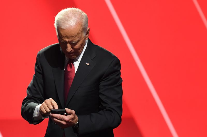 Former Vice President Joe Biden poking at a mobile phone in October 2019.