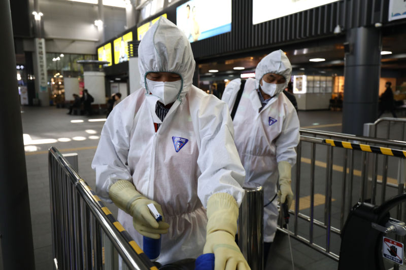 SEOUL, SOUTH KOREA - JANUARY 24: Disinfection workers wearing protective gear spray anti-septic solution in a train terminal amid rising public concerns over the spread of China's Wuhan Coronavirus at SRT train station on January 24, 2020 in Seoul, South Korea.