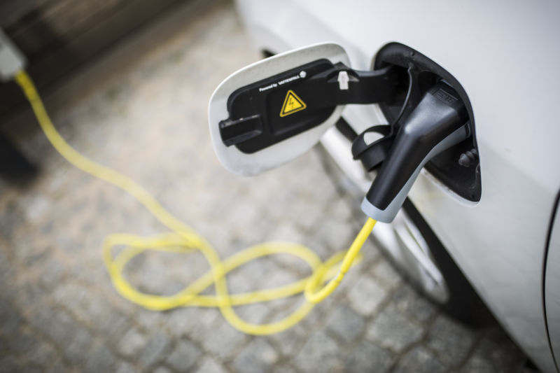 An electric car is pictured during charging on April 24, 2018 in Berlin, Germany