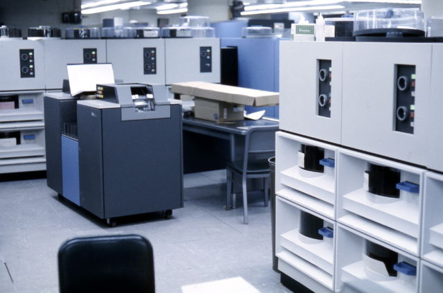A number of IBM 2314 disk drives (white) and an IBM 2540 Card Reader / Punch, photographed in 1968.