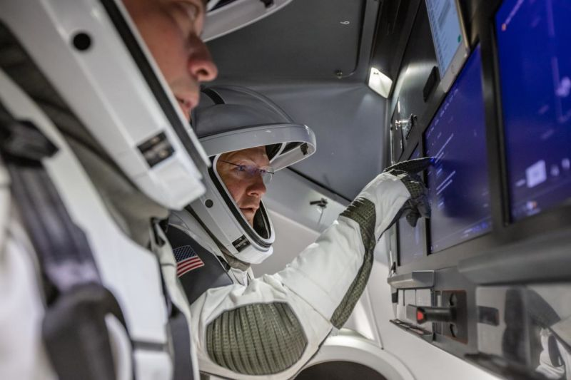 NASA astronauts Doug Hurley and Bob Behnken familiarize themselves with SpaceX's Crew Dragon.