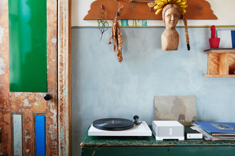 Promotional image of record player in bohemian studio.