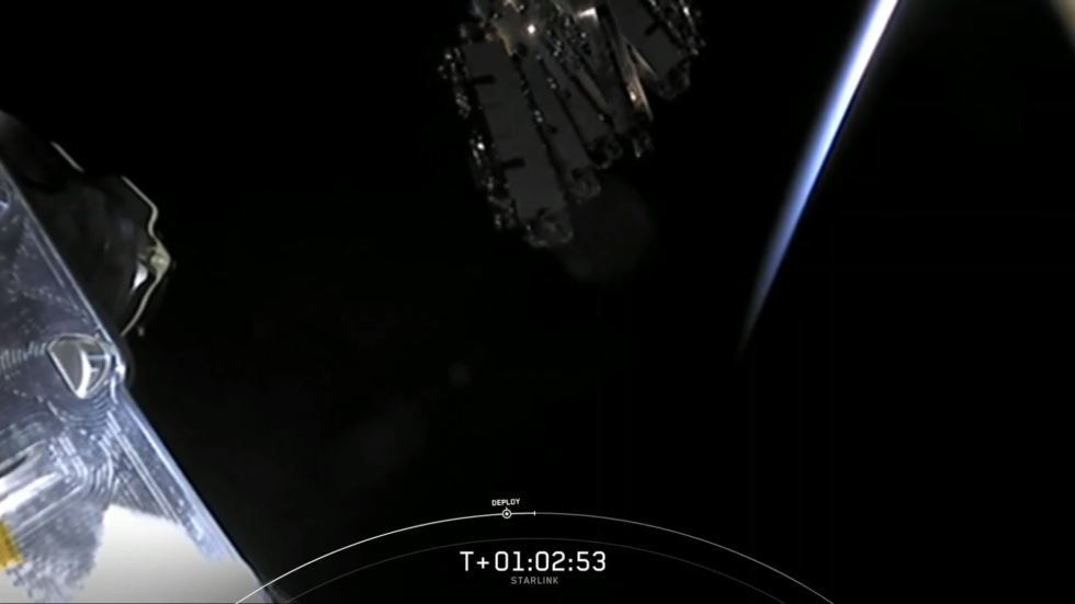 Deployment of Starlink satellites with the limb of the Earth in the background.