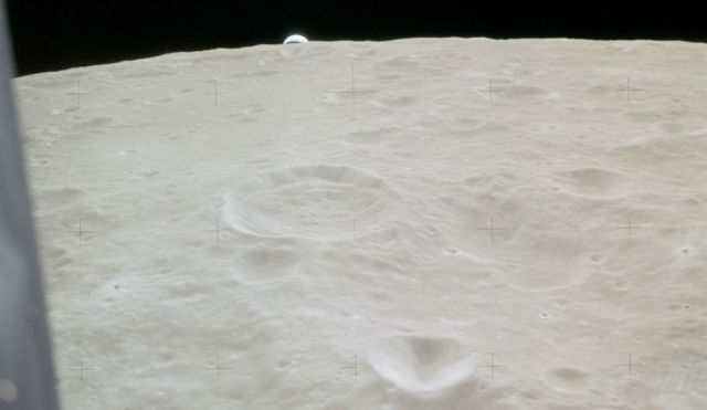 """The Earth rises over the limb of the Moon, as seen from <em>Antares</em> during descent. The large foreground crater is <a href=""""https://en.wikipedia.org/wiki/Meitner_(lunar_crater)"""">Meitner</a>."""