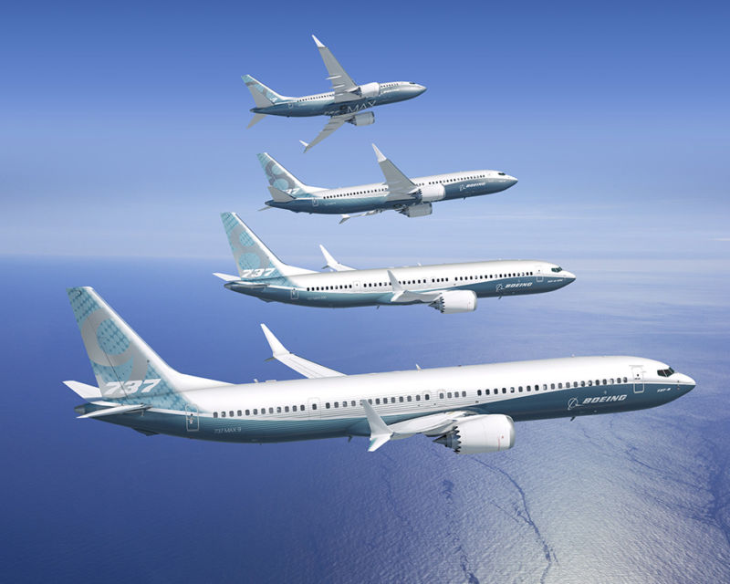 Four Boeing 737 Max planes in the air.