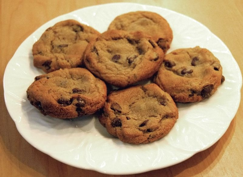 A plate of chocolate-chip cookies.