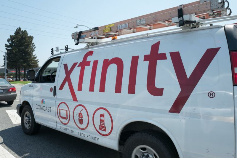 A Comcast service van with the brand name