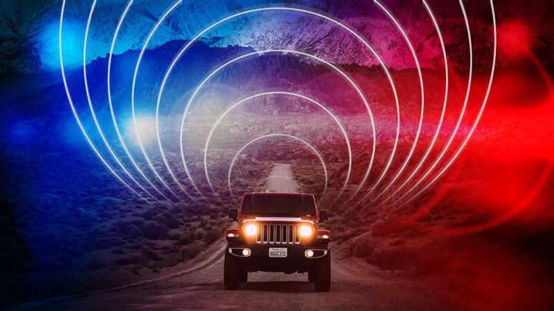 Heavily modified photograph of jeep driving across desert terrain.