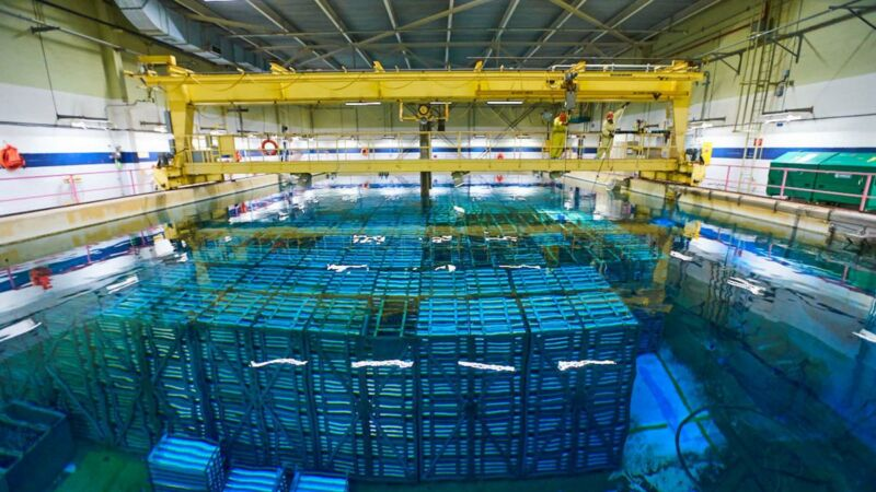 Image of blocks of material submerged under water in a storage facility.