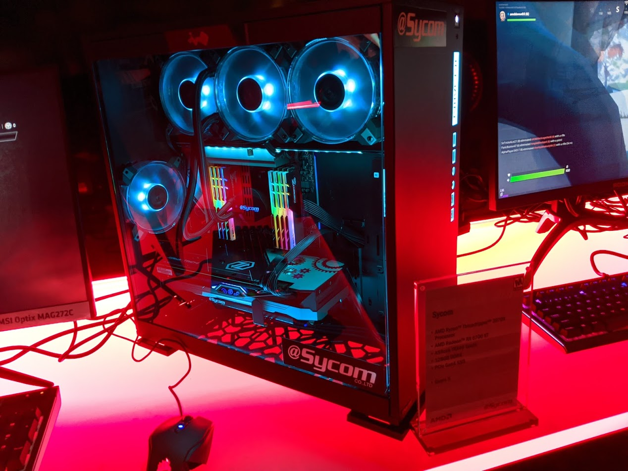 """There was an entire wall full of gigantic Threadripper systems like this Sycom. I caught one of the serving staff fanning herself while staring at one and asking another server """"are these things making it hot in here?"""""""