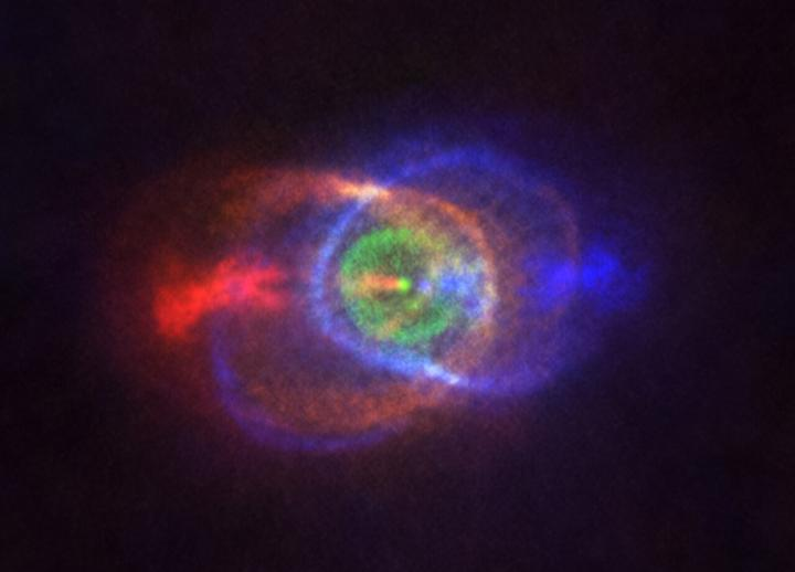 Red- and blue-shifted material in the vicinity of the star system, with green indicating material that's not moving relative to Earth.