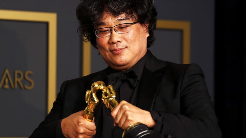 Three-time Oscar winner Bong Joon-ho makes his statuettes kiss. Legend.