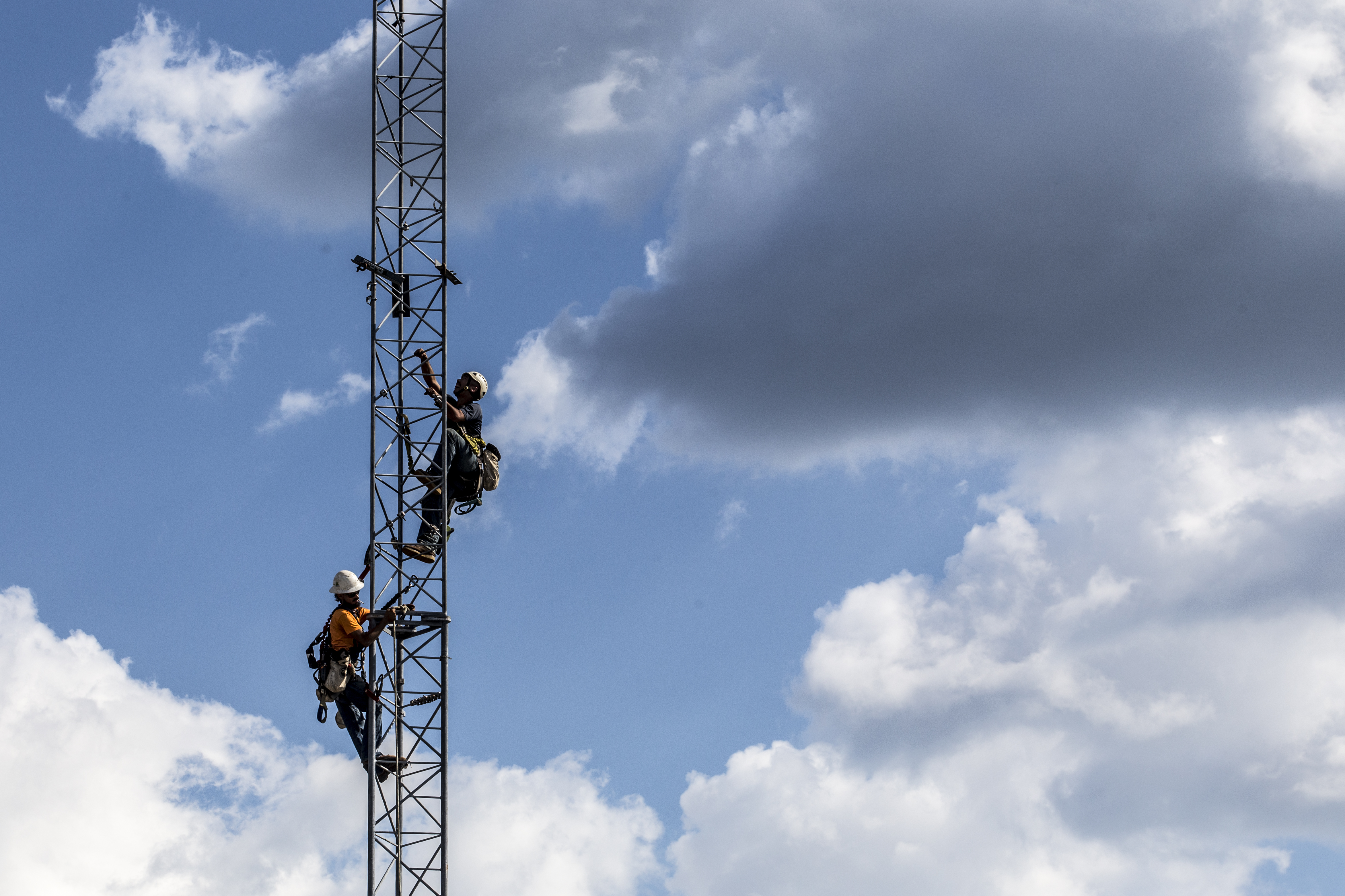 Verizon Communications Inc. workers install a temporary cell tower after Hurricane Florence hit in Newport, North Carolina, in September 2018.